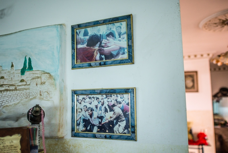 The photographs on the livingroom wall of Rani on the day he was shot.